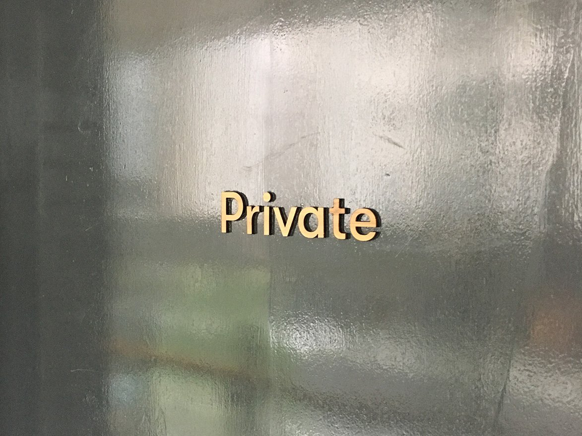 Private walnut signage